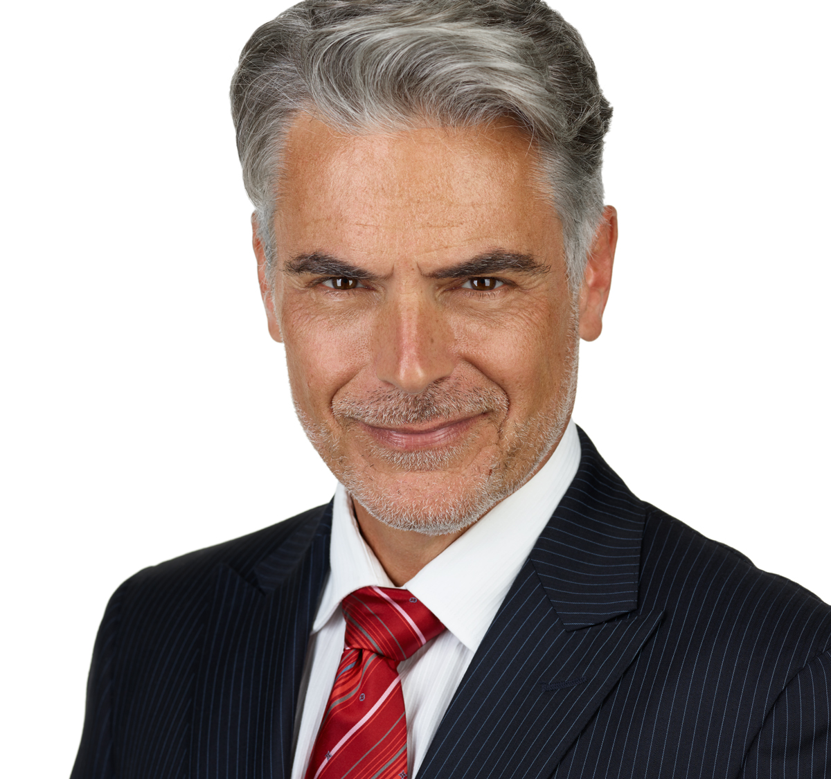 Professional headshot of a male corporate businessman in a suit and tie taken at NYC Headshot.