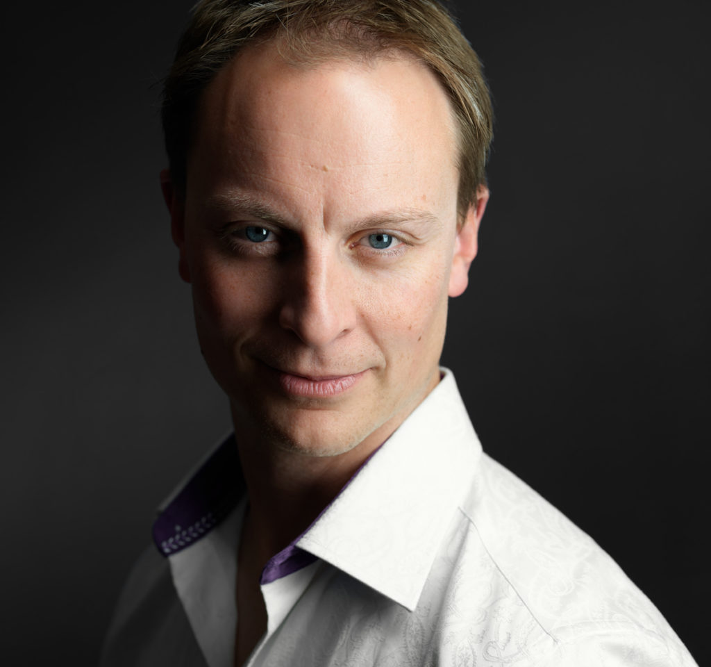 Professional headshot of a male actor wearing a white dress shirt taken at NYC Headshot